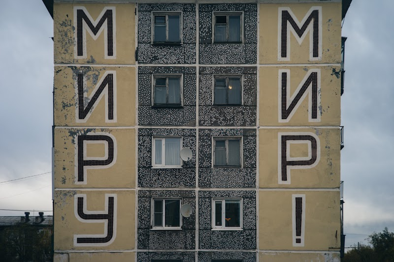 Peace to the World on Soviet Modernist building in Vorkita Russia